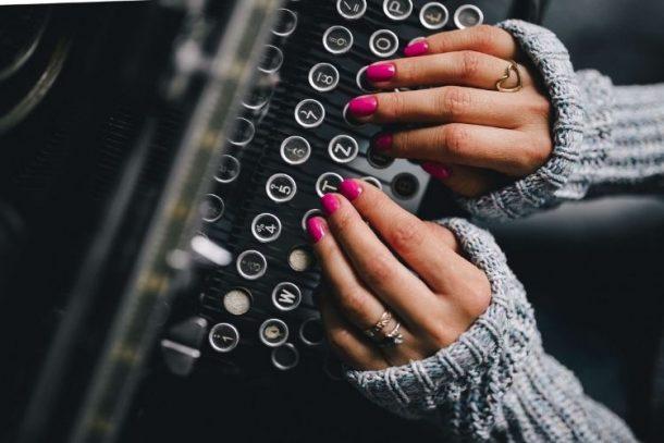 hands on typewriter subscribing to newsletter