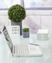 a clean tidy workspace with white laptop on a clear desk